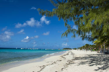 Tranquil view of Norman Saunders beach against blue sky on sunny day, Grand Turk, Turks And Caicos Islands - RUNF03234