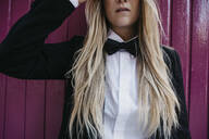 Blond young woman wearing black tie and blazer, partial view - LHPF00967