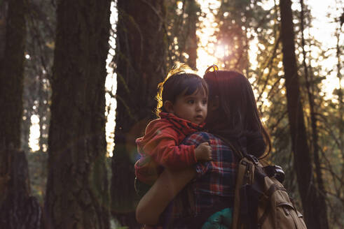 Mother holding a little girl in the forest at sunset in Sequoia National Park, California, USA - GEMF03174