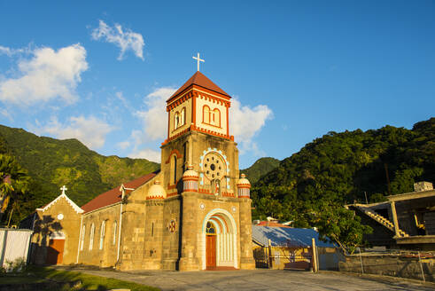 Low angle view of Anglican church against blue sky in Soufriere, Dominica, Caribbean - RUNF03251