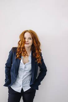 Portrait of redheaded businesswoman - KNSF06627