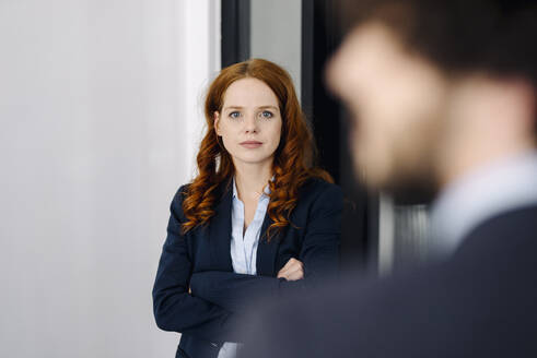 Portrait of confident redheaded businesswoman - KNSF06630