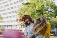 Two exuberant female friends headbanging in the city - KNSF06690