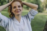 Portrait of redheaded woman in a park - KNSF06702