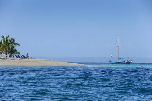 Scenic view of Bacardi island against clear blue sky at Samana Peninsula, Dominican Republic - RUNF03264