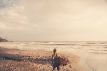 Surfer on beach - JOHF01103