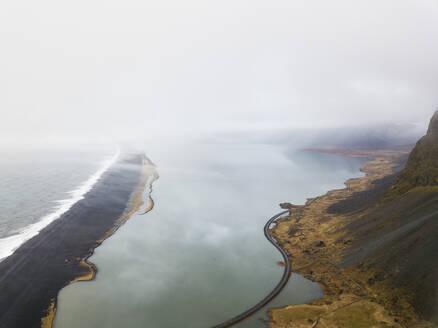 Iceland, Aerial view of empty highway along coastline ofJokulsarlonlake - DAMF00070