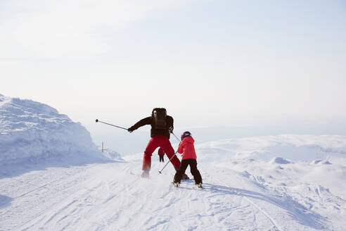 Father and son skiing - JOHF01583