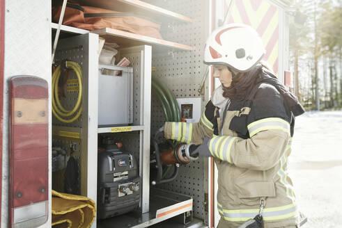Firefighter near fire engine - JOHF01853
