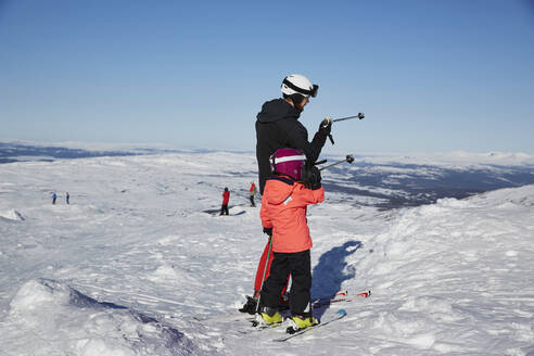Father and son skiing - JOHF01907