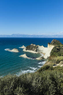 Scenic view of Corfu against blue sky during sunny day, Ionian islands, Greece - RUNF03322