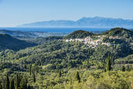 High angle view of mountain village against cleat sky during sunny day, Corfu, Ionian islands, Greece - RUNF03325