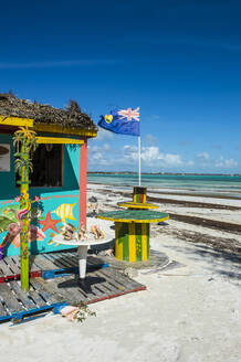 Shop at Five Cays beach against blue sky during sunny day, Providenciales, Turks And Caicos Islands - RUNF03340