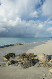 Scenic view of rainbow over Grace Bay beach, Providenciales, Turks And Caicos Islands - RUNF03343