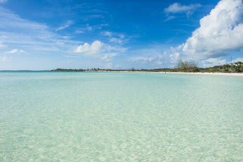 Scenic view of Taylor beach against blue sky during sunny day, Providenciales, Turks And Caicos Islands - RUNF03352