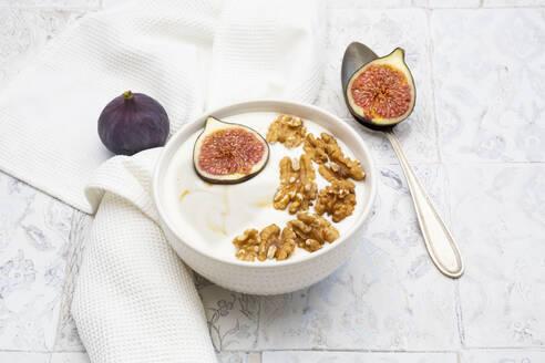 Bowl of Greek yogurt with honey, walnuts and fig - LVF08293