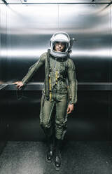 Man posing dressed as an astronaut in an elevator - DAMF00104