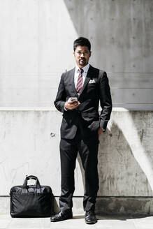 Portrait of confident young businessman in the city - JPIF00184