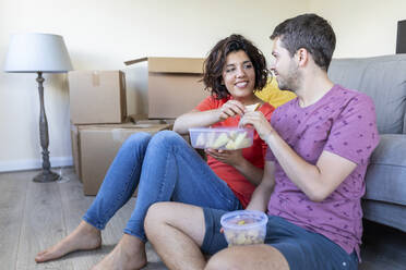Happy couple moving into new home taking a break and having lunch - WPEF01943