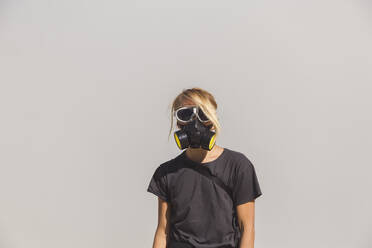 Young woman with espirator mask at Ijen volcano, Java, Indonesia - KNTF03583