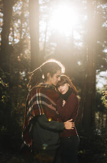 Young couple in love in forest - DAMF00120