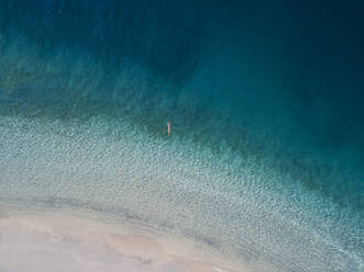 Woman floating in the sea, Gili Air, Gili Islands, Indonesia - KNTF03598