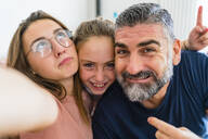 Selfie of happy father with two daughters - MGIF00719