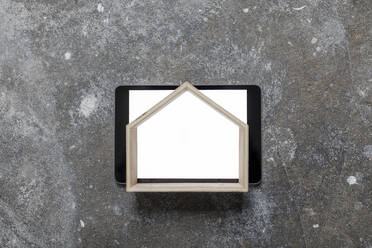 House model on blank tablet, elevated view - GUSF02670