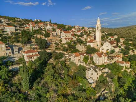 Aerial view of traditional dalmatian village of Lozisca, Brac Island, Croatia - AAEF03721