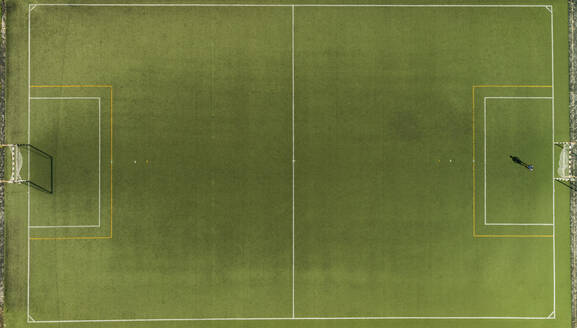 Aerial view of a football training on synthetic surface football pitch on a summer day. - AAEF04234