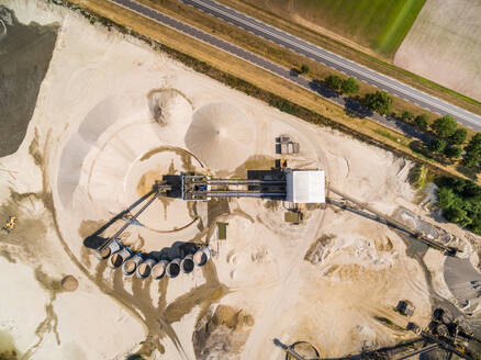 Aerial view of a sand factory near the road, Netherlands - AAEF04444