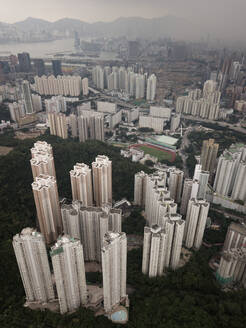 Aerial view of residential tower blocks in Hong Kong, China - AAEF04456