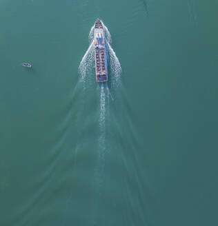 Germany, Bavaria, Aerial view of tourboat sailing across turquoise waters of Chiemsee lake - MMAF01157
