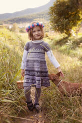 Young girl with dog walking in nature - XCF00260