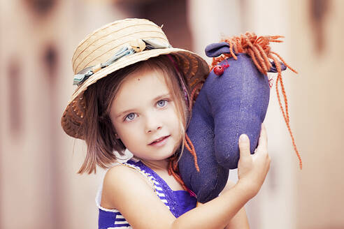 Portrait of little girl with hobby horse - XCF00268