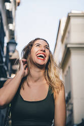 Portrait of laughing woman in the city - CJMF00059