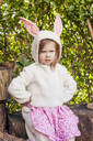 Portrait of angry little girl wearing Easter bunny costume - XCF00273