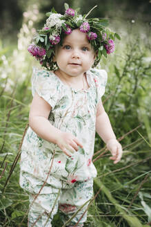 Portait of cute little girl with flower wreath on her head - EYAF00514