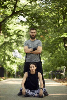 Portrait of sporty couple on forest path - ZEDF02638