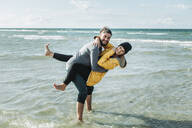 Happy couple at the beach - NAF00161
