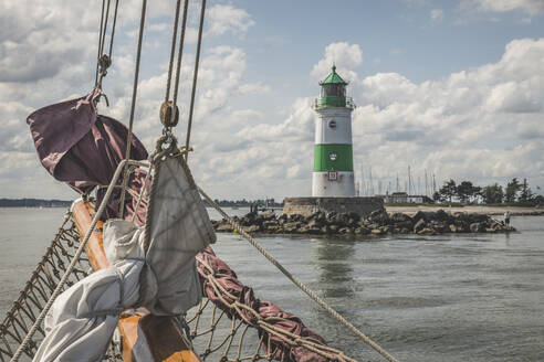 Germany, Schleswig-Holstein, Schleimunde lighthouse seen from gaff schooner boat - KEBF01348