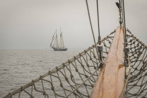 Denmark, Baltic Sea, Sailing ship seen from gaff schooner bowsprit  - KEBF01357