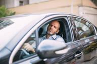 Businessman sleeping while driving his car - CJMF00076