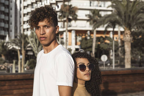 Cool couple in the city, standing back to back - RCPF00037