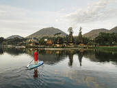 Female sup surfer at Bratan lake - CAVF64984