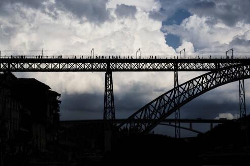 Portugal, Porto, Silhouette of Dom Luis I Bridge against large clouds - MRF02202