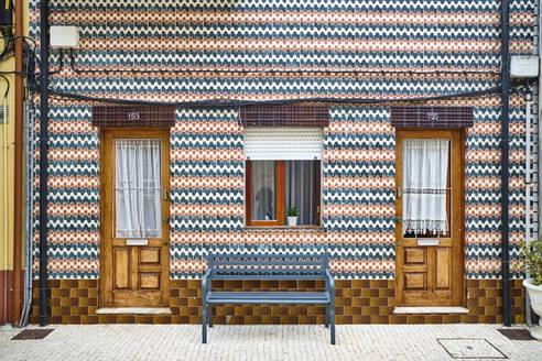 Portugal, Porto, Afurada, Unique ornate house facade seen from pavement - MRF02238