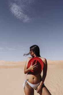 Sexy young woman with bikini pants and hat in the desert, Merzouga, Morocco - DAMF00132