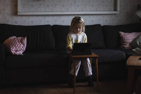 Girl using digital tablet - JOHF02279