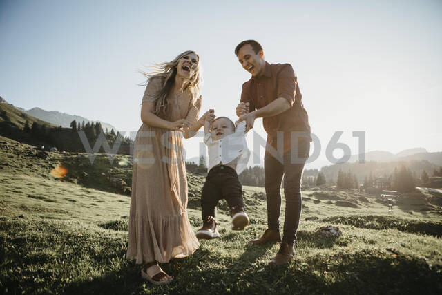 Happy family playing with little son on a hiking trip, Schwaegalp, Nesslau, Switzerland - LHPF01096 - letizia haessig photography/Westend61